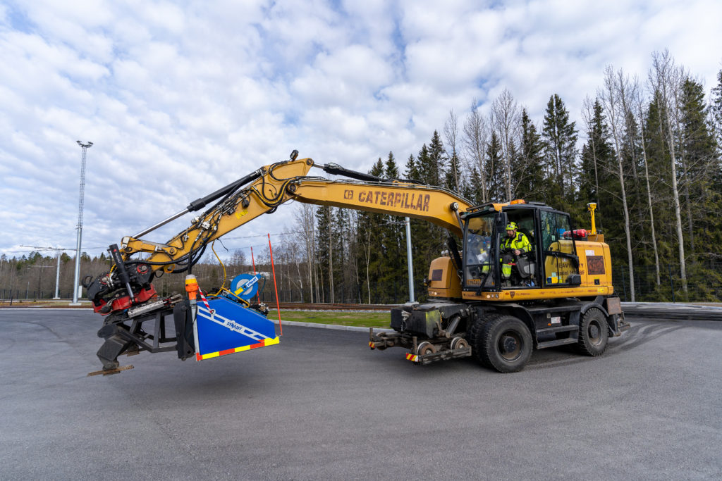 An excavator that is equipped for tramway maintenance