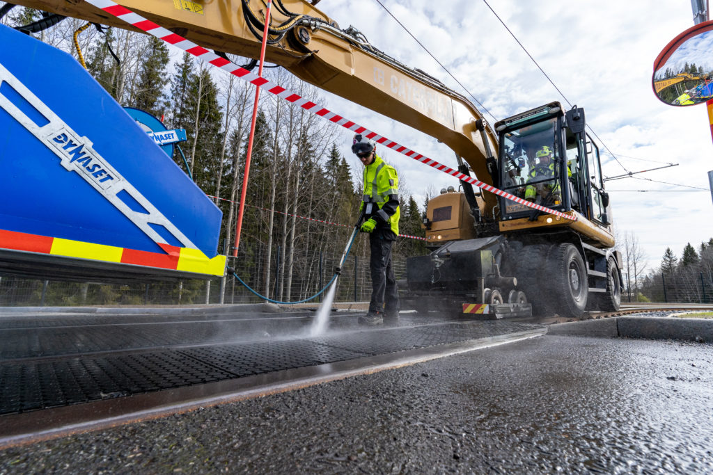 Excavator with street washing unit and power washer