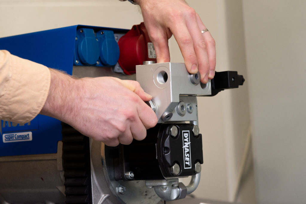 Add-on valve from DYNASET Accessories list that is installed onto DYNASET HG Hydraulic Compressor